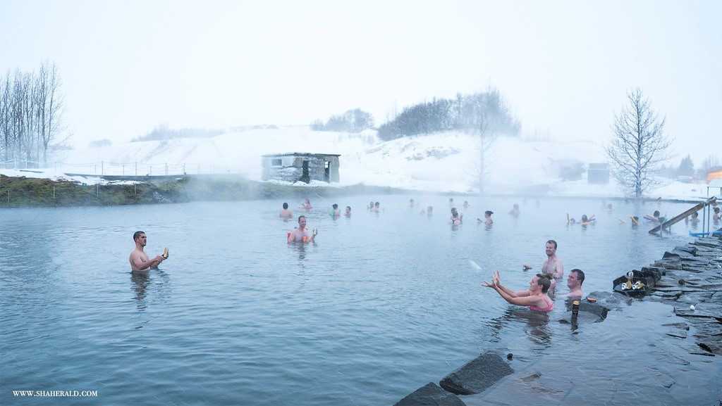people bathing in the secret lagoon in Iceland